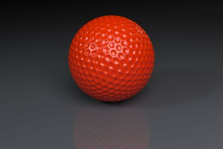 Red golfball on gray slightly reflective background Stock Photo
