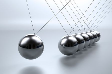 physics: Metal pendulum balls balancing from strings in Newtons cradle