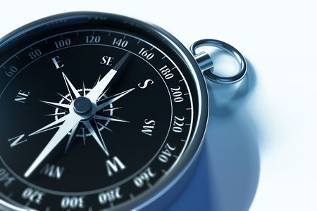 Closeup of a compass with shallow depth of field photo