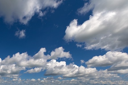 Large background image of blue sky with cumulus clouds