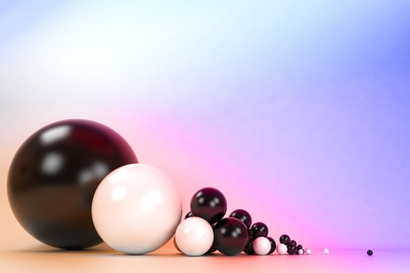 Plastic balls of different sizes on a colorful background Stock Photo