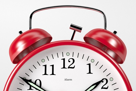 A classic red alarm clock on white background