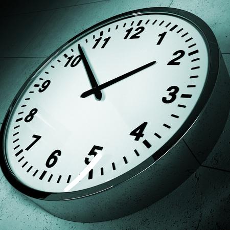 A modern clock on a grungy concrete wall