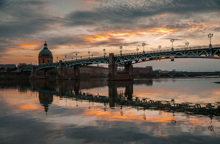 pierre: Sunset in Toulouse with the bridge Saint Pierre reflected in the waters of the river Garonne
