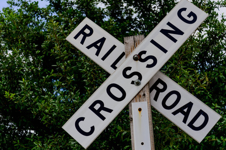 wood railroad: railroad crossing sign on a wood post