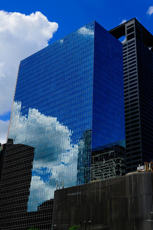 tx: reflective glass building in downtown houston