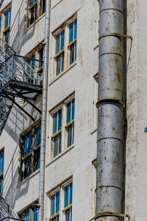 escapes: old building with fire escapes in downtown houston Stock Photo