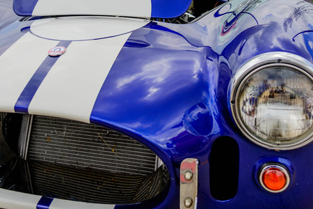 stripe: Restored blue Shelby Cobra with white racing stripes