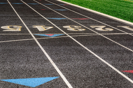 lane lines: outdoor black running track with painted lane lines