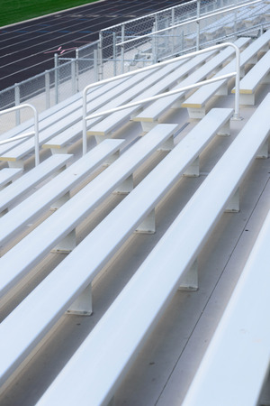 bleachers: outdoor black running track with painted lane lines from the bleachers