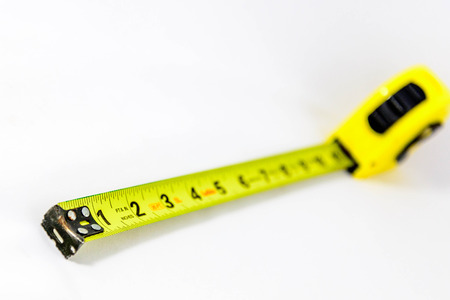 a yellow extended tape measure 版權商用圖片