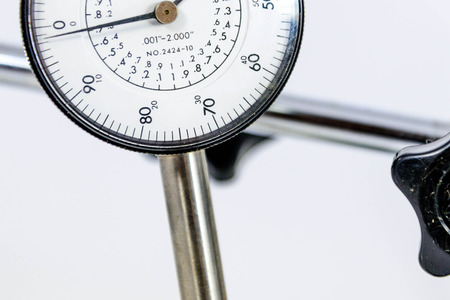 a pressure gauge with black text on a white face Banco de Imagens