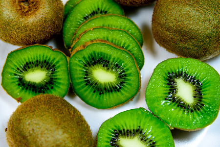 sliced green ripe kiwi ready to eat Banco de Imagens