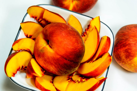 sliced fresh ripe peaches ready to eat