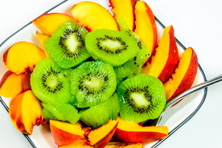 sliced fresh ripe kiwi and peaches ready to eat Imagens - 31028608