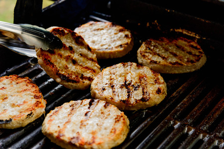 sizzle: turkey burgers cooking on the grill