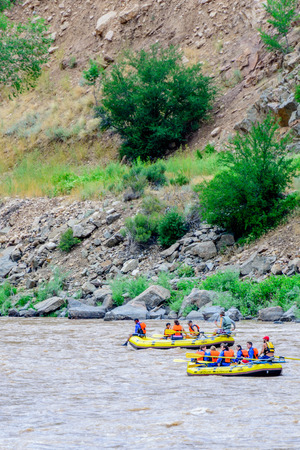 rafters: rafters paddling down a river