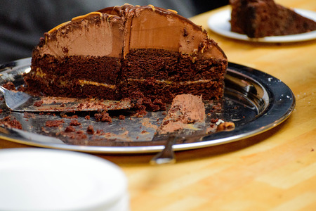 Chocolate cake being served at a business party