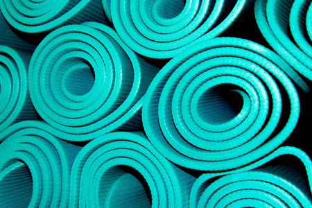 gym equipment for exercise, rolled yoga mats Stock Photo