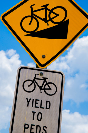 bicycle traffic signs yellow black, steep downhill, yield to peds