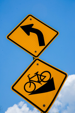 bicycle traffic signs yellow black, steep downhill, left turn