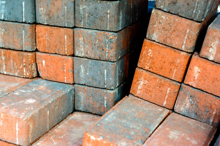 stacked masonry building materials, bricks Stock Photo