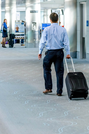 denver co: DIA, DEN, Denver International Airport, CO - People walking with luggage in airport Editorial
