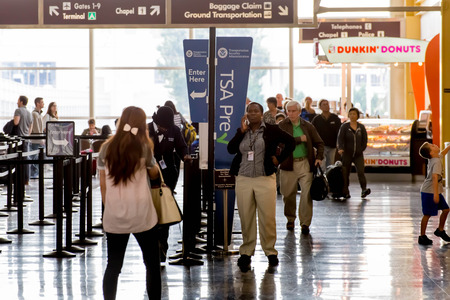 lines: DCA, Reagan National Airport, Washington, DC - Passengers in the TSA line in an airport