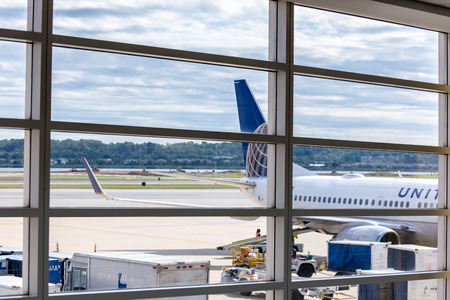 DCA, Reagan National Airport, Washington, DC - View out airport window to airplanes and ramp operations Editorial