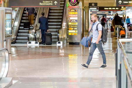 denver co: DIA, DEN, Denver International Airport, CO - People walking with luggage in an airport