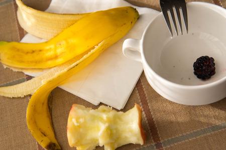 consumed breakfast - empty bowl, banana peel and apple core