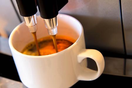 espresso dripping form the coffe machine