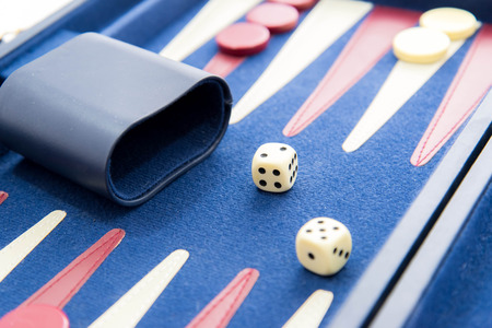 backgammon: board games - red white and blue backgammon set in play Stock Photo