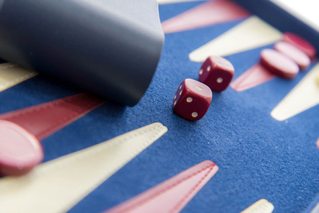 board games - red white and blue backgammon set in play Stock Photo