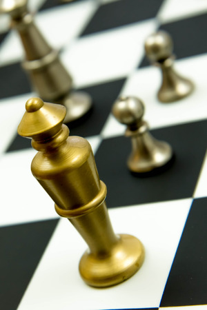 Classic chess game - king and pawns on chessboard