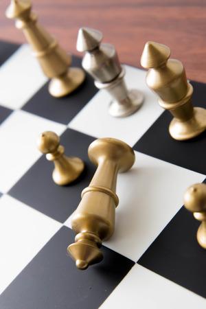 Classic chess game - fallen gold king on chessboard Reklamní fotografie