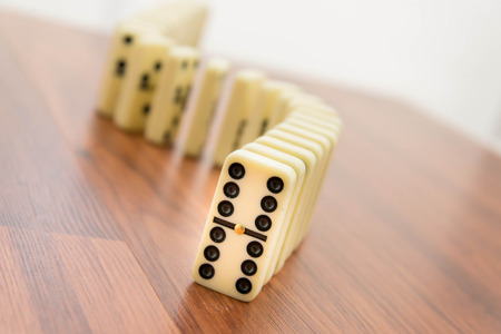 Domino tiles standing vertically in a line