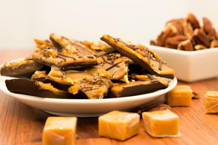indulgent: indulgent dessert - rich chewy sweet caramel chocolate and pecan treat
