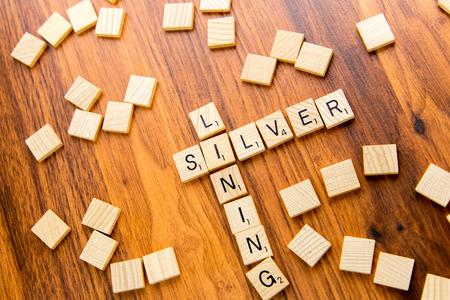 lining: Scrabble tiles spelling SILVER LINING