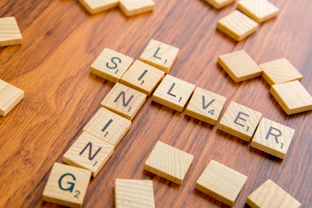 lining: word board tiles spelling SILVER LINING