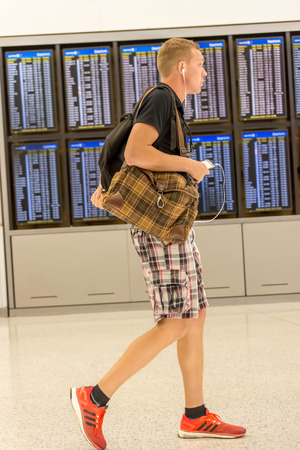 IAH, Houston Intercontinental Airport, Houston, TX, USA - passengers walking with lugagge in airport