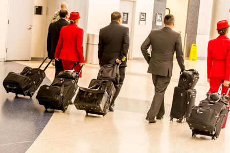 lugagge: IAH, Houston Intercontinental Airport, Houston, TX, USA - passengers walking with lugagge in airport