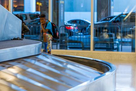 intercontinental: IAH, Houston Intercontinental Airport, Houston, TX, USA - luggage carousel at baggage claim Editorial