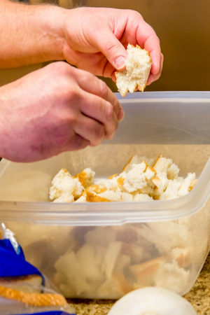 stuffing: stuffing preparation - tearing pieces of white bread