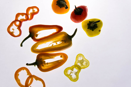 yellow, red and orange sliced hot peppers with backlighting