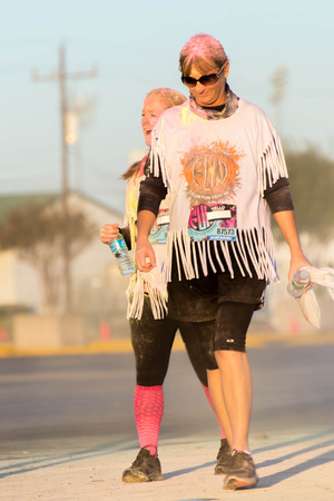 tx: November 1, 2014 - Houston, TX, USA: Color Fun Fest 5K run. Runners completing the course with colored powder