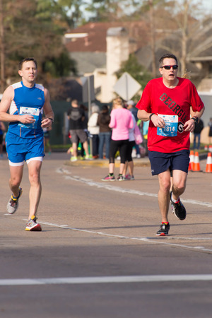 houston: January 18, 2015 - Houston, TX, USA: Houston 2015 Marathon runners on Memorial Drive after passing mile 22