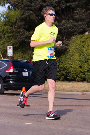 18: January 18, 2015 - Houston, TX, USA: Houston 2015 Marathon runners on Memorial Drive after passing mile 22