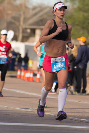 January 18, 2015 - Houston, TX, USA: Houston 2015 Marathon runners on Memorial Drive after passing mile 22