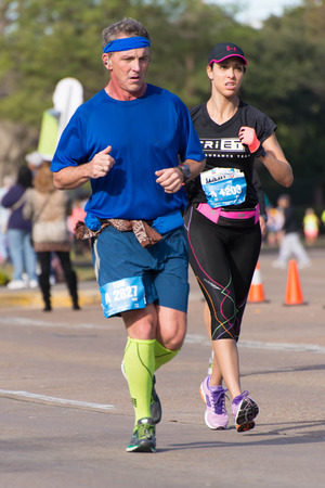 tx: January 18, 2015 - Houston, TX, USA: Houston 2015 Marathon runners on Memorial Drive after passing mile 22